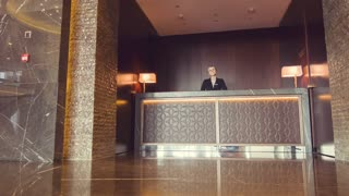 Cheerful female receptionist welcoming guests