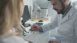 Chief ophthalmologist consulting young doctor