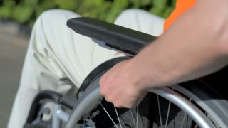 Close up of disabled man using wheelchair