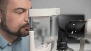 Close up of eye examination on slit lamp
