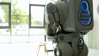 Close up of robot walking in office