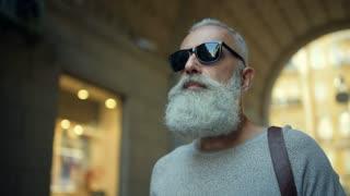 Confident mature man promenading in downtown