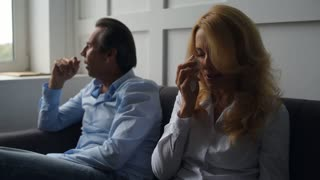 Crying woman talking with her husband