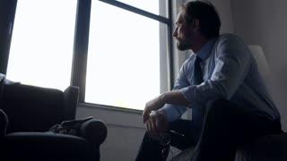Depressed adult businessman feeling sad after being fired