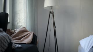 Depressed adult woman standing up from her bed