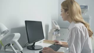 Female doctor working with computer