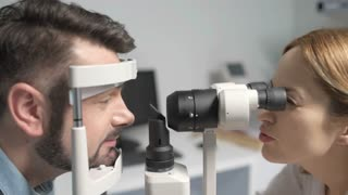 Female optometrist doing sight testing for patient