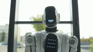Friendly robotic machine waving hello