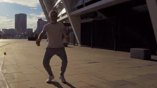 Full length of a senior man doing squats