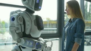 Funny robotic machine dancing with girl