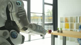 Innovative robot treating young lady with breakfast
