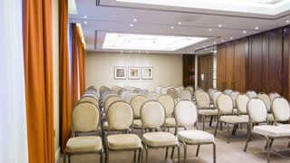 Little conference room with chairs standing in rows