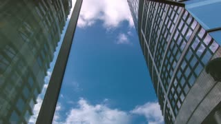 Low angle of tall business center with businessman standing nearby
