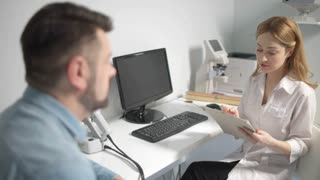 Male patient having consultation with eye doctor