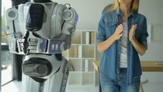 Mindful girl teaching robot new dance