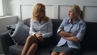 Nervous women having unpleasant talk
