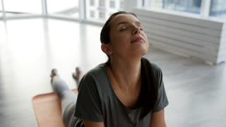 Peaceful mind. Close up of young marvelous woman stretching her body while feeling relaxed and pleased