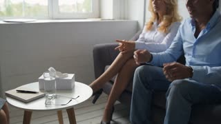 Pleased couple being grateful to psychologist