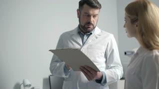 Portrait of two doctors having consultation