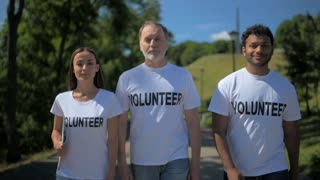 Positive international volunteers going to help people