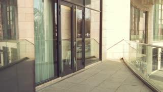 Professioanl businessmen entering the office building