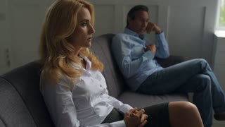 Sad couple sitting in psychologists office