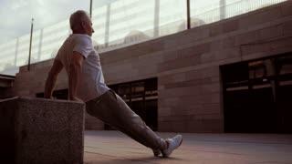 Senior strong man doing sport exercises