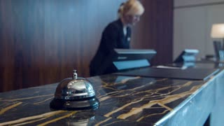 Service bell standing on marble reception desk