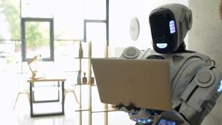 Smart robot browsing internet on laptop