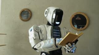 Smart robot reading interesting book