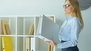 Successful business lady looking through document