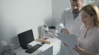 Two doctors consulting in medical office