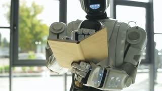 White shiny robot writing down information