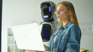 Woman and robot working as team in office