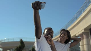 Young African American friends having fun and taking photos