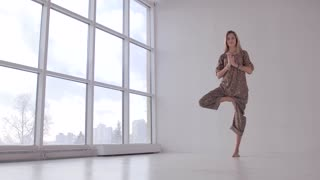 Attractive yoga woman practicing balancing yoga poses