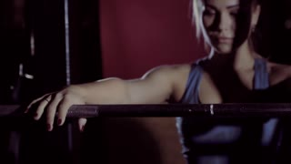 Beautiful fitness woman starting weight-lifting exercise