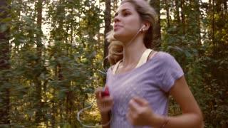 Beautiful girl enjoying her gentle run in the green park