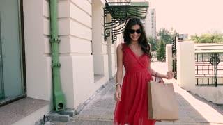 Beautiful smiling woman walking on the street