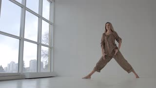 Beautiful yoga woman practicing yoga and standing in revolved side angle pose