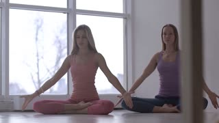 Beautifully-shot calm lovely women deepening their breathing