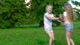 Children enjoying a summer day in green park playing, running and laughing together