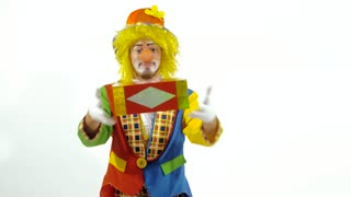 Circus clown smiling widely and reaching out hands with bright box in them