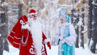Ded Moroz Father Frost showing Snegurochka Snow Maiden the New Year gifts