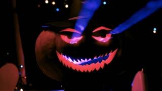 Evil Halloween pumpkin glowing with laser light