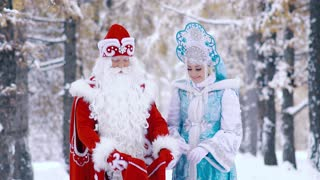 Father Frost showing Snowflake the gifts for children