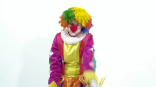 Funny and pretty clown making faces in front of the camera