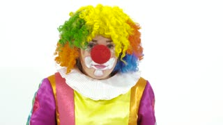 Funny clown pretends he doesn it hear and picks up big ear