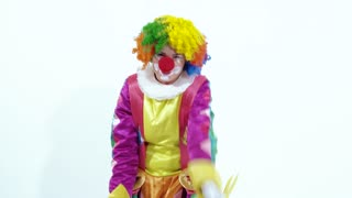 Funny young female clown dancing comically thinking she is pretty