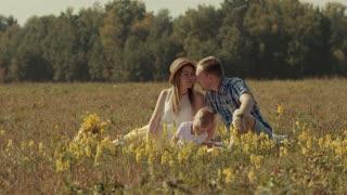 Joyful family enjoying their picnic in nature